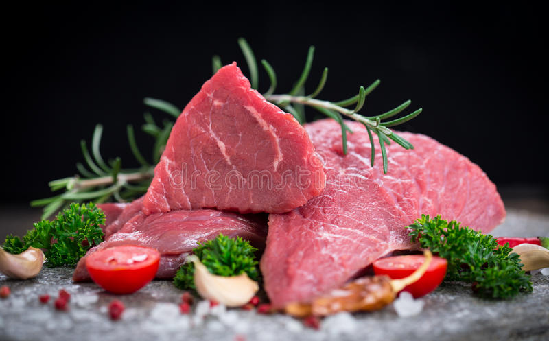 Raw beef meat with spices. On the table stock image