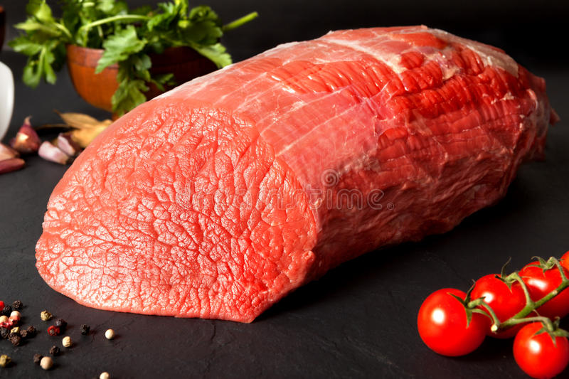 Raw beef round stock images