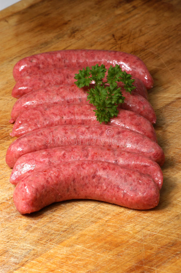 Raw beef sausages royalty free stock image
