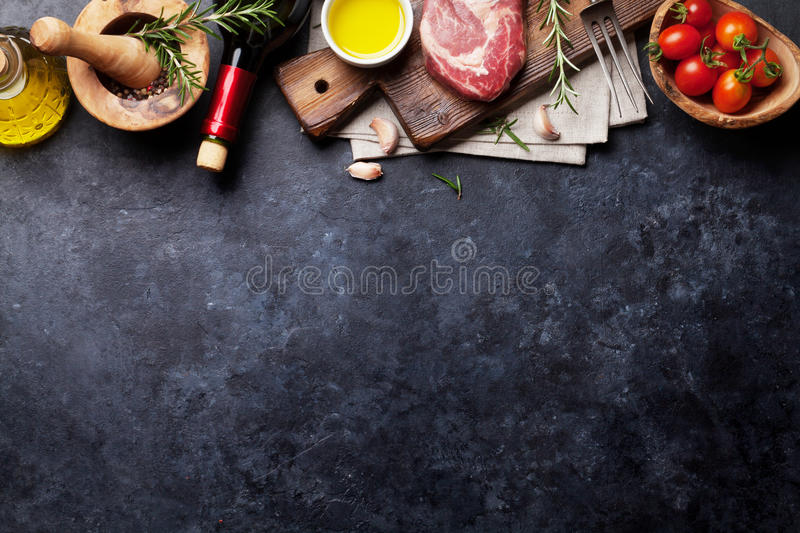 Raw beef steak cooking royalty free stock image