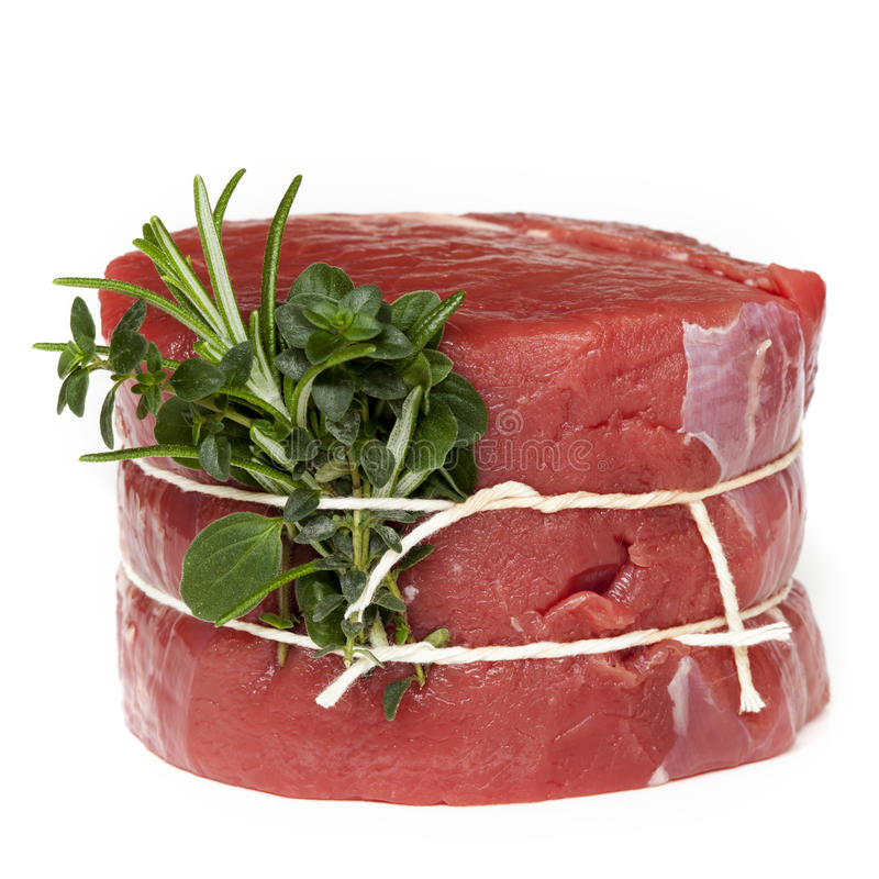 Raw Beef Steak with Herbs Isolated royalty free stock photography