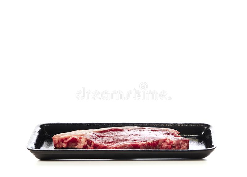 raw beef steak in  package on white royalty free stock photos