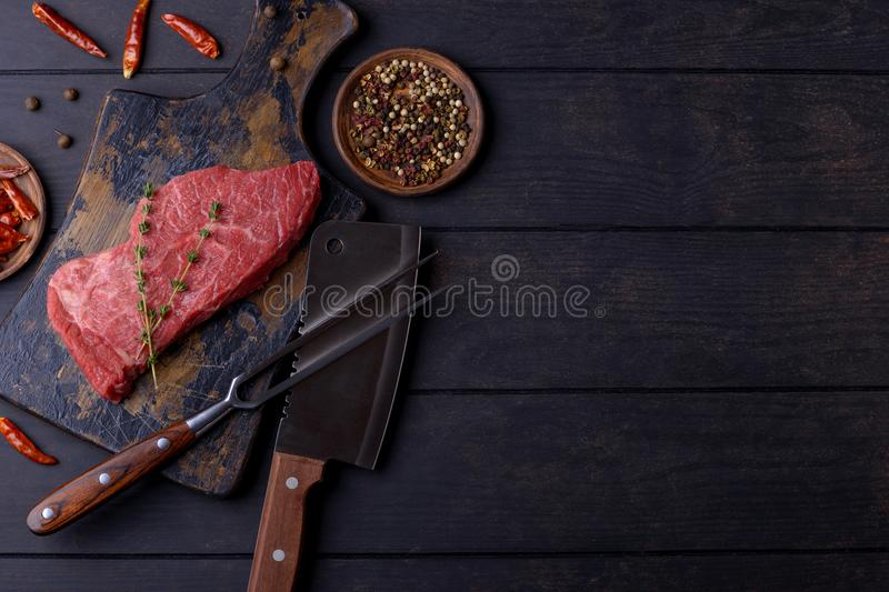 Raw beef steak with spice royalty free stock photos