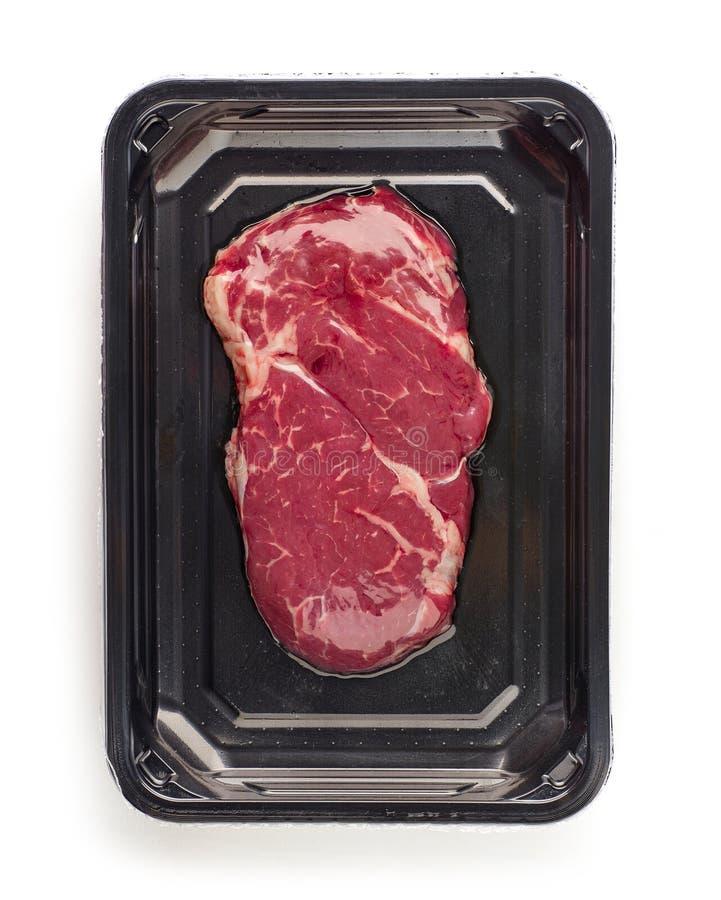 Raw beef steak in vacoom package stock photo