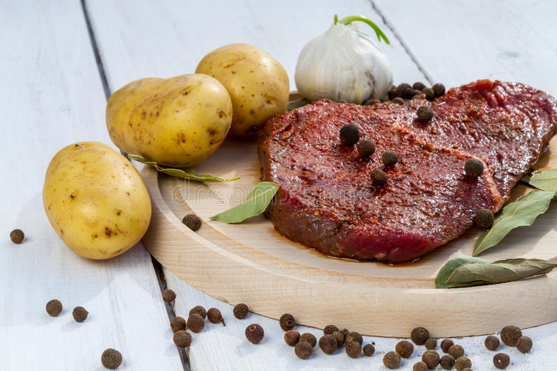 Raw beef steak with vegetables royalty free stock images
