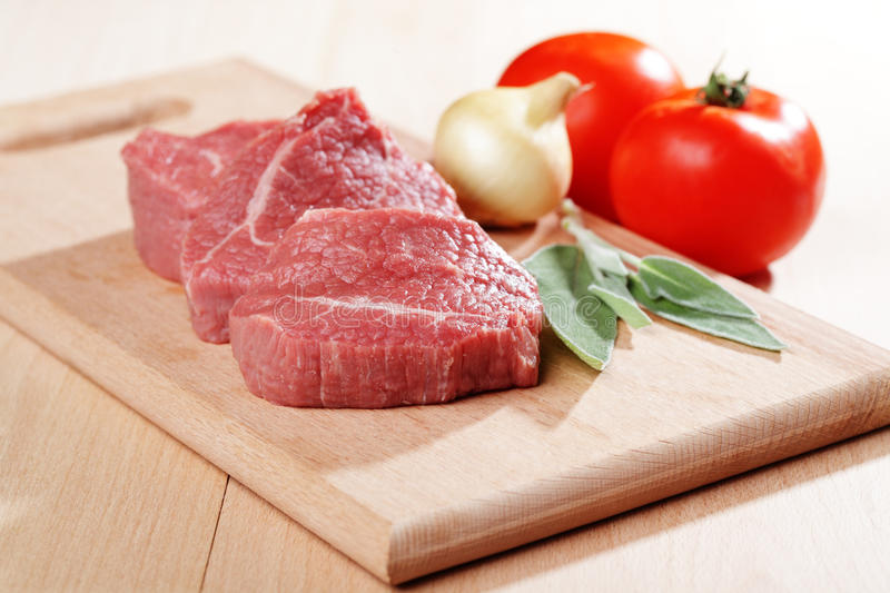 Raw beef steakes stock images