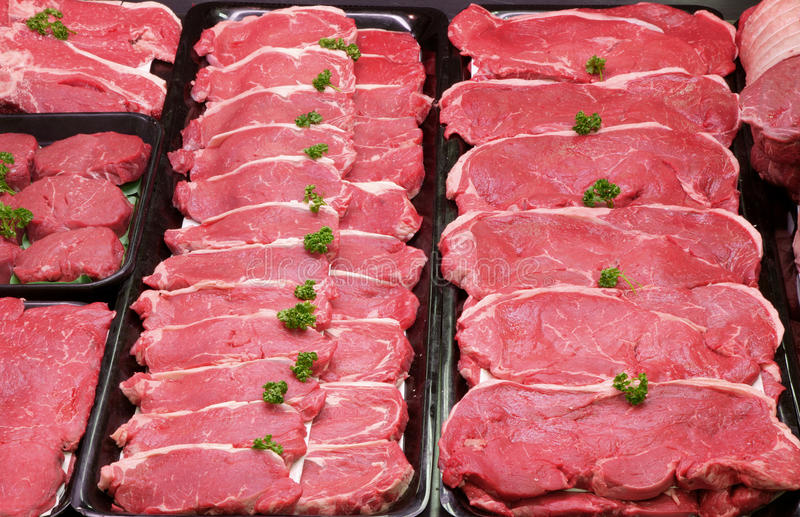 Raw Beef Steaks royalty free stock photos