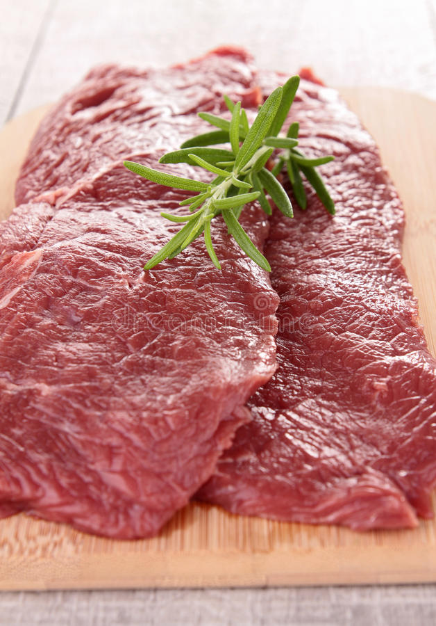 Raw beefsteak. Close up on fresh raw beefsteak royalty free stock images