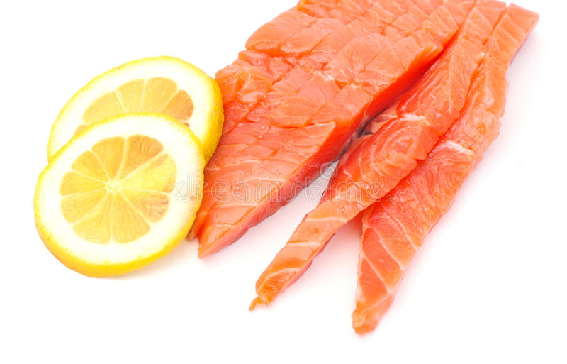 Raw big salmon bar with lemon royalty free stock photography