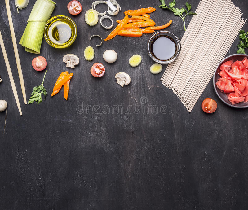 Raw buckwheat noodles, pickled ginger, onion, chopped pepper, chopsticks, soy sauce, ingredients cooking Asian food border ,pl. Raw buckwheat noodles, pickled stock photo