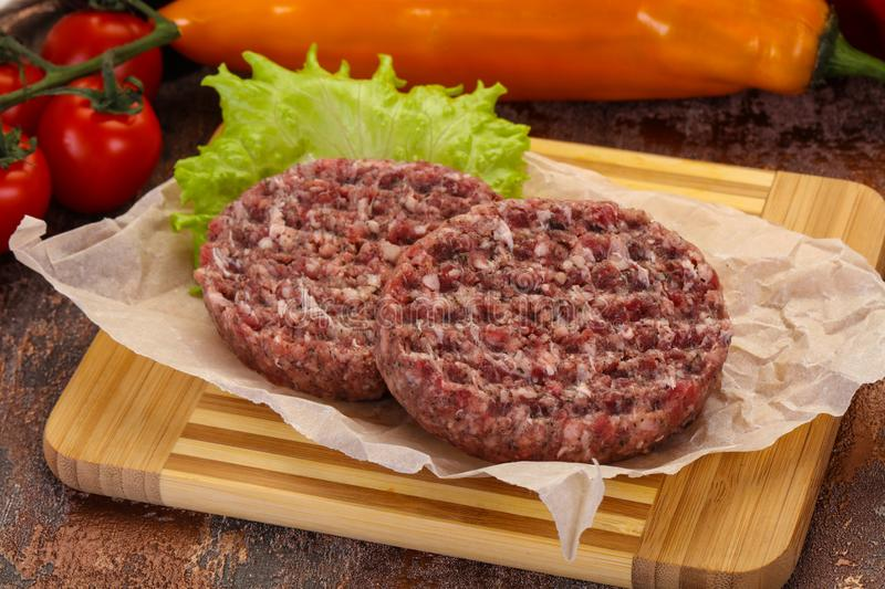 Raw burger cutlet royalty free stock photo