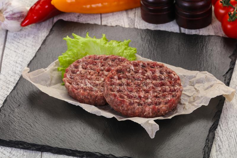 Raw burger cutlet stock photos