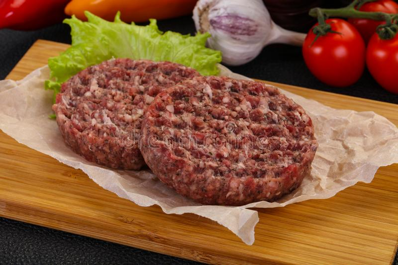 Raw burger cutlet royalty free stock images