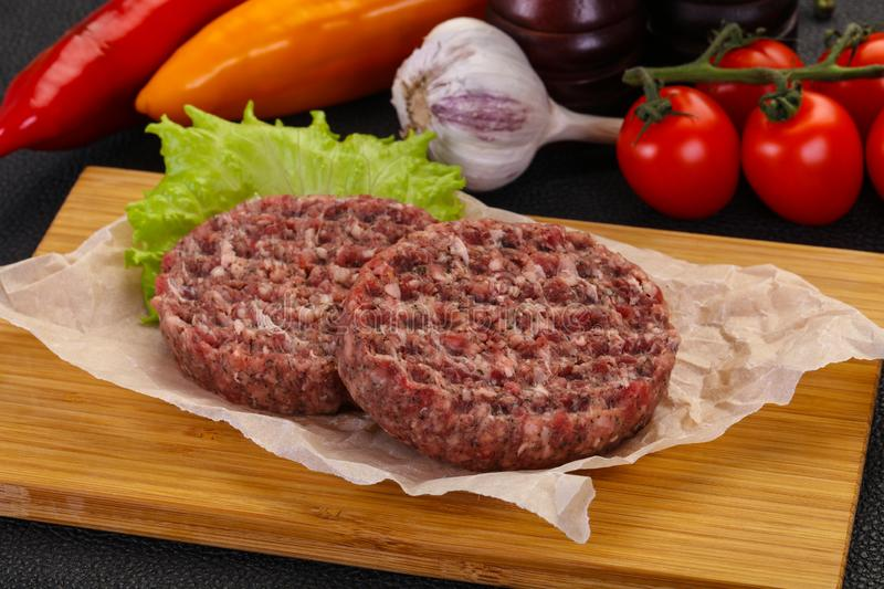 Raw burger cutlet stock images