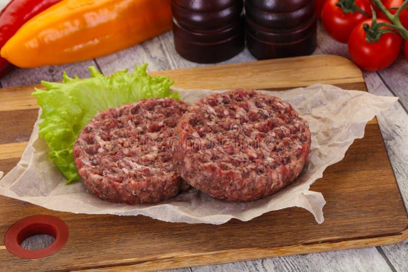 Raw burger cutlet stock photo