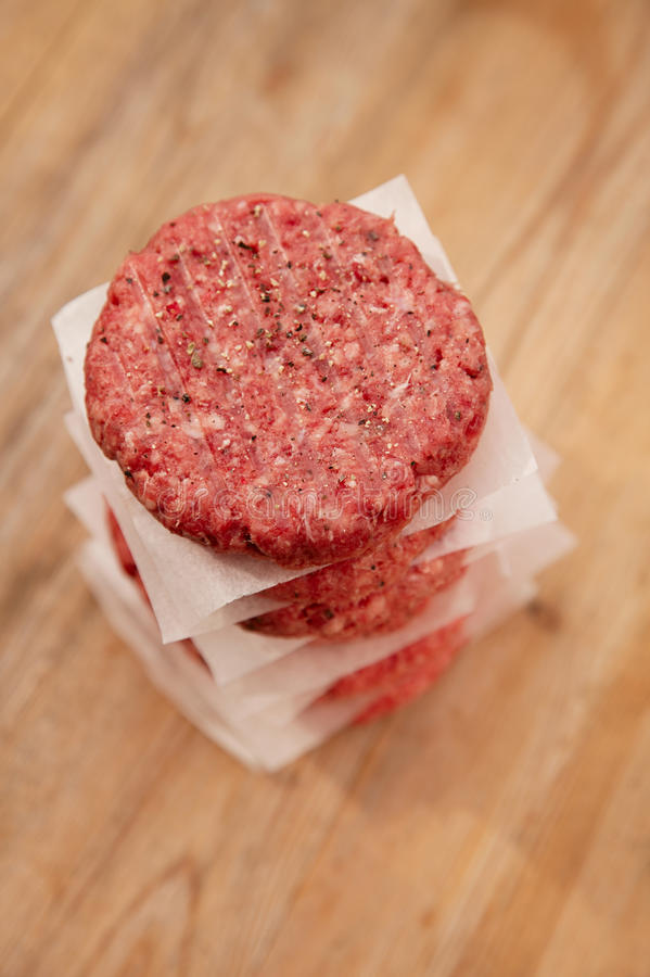 Raw burgers for hamburgers, in a pile stock photos
