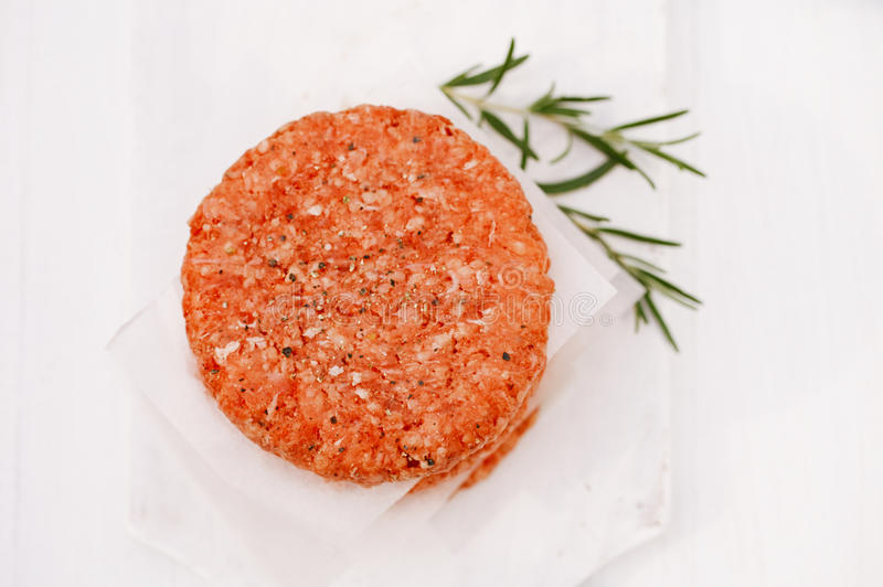 Raw burgers for hamburgers, in a pile royalty free stock photos