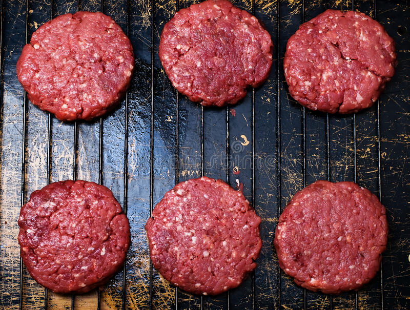 Raw burgers from organic beef royalty free stock images
