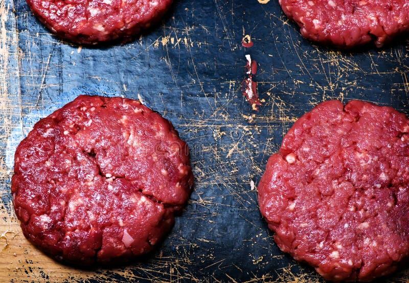 Raw burgers from organic beef stock photos