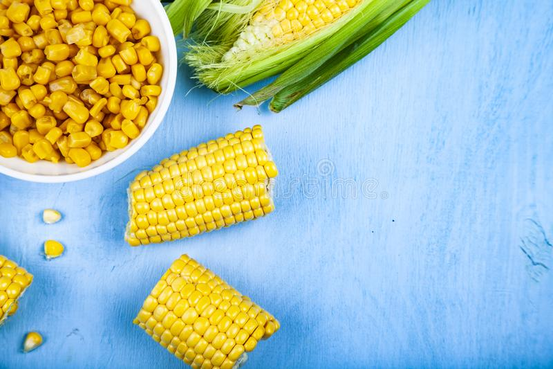 Raw and canned corn in a white bowl. royalty free stock images