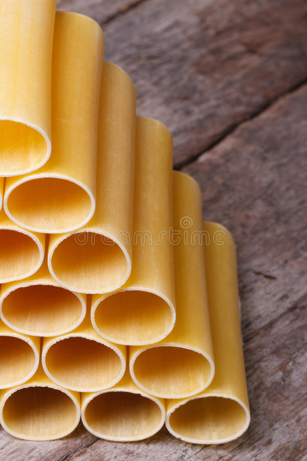 Raw cannelloni on an old wooden board stock image
