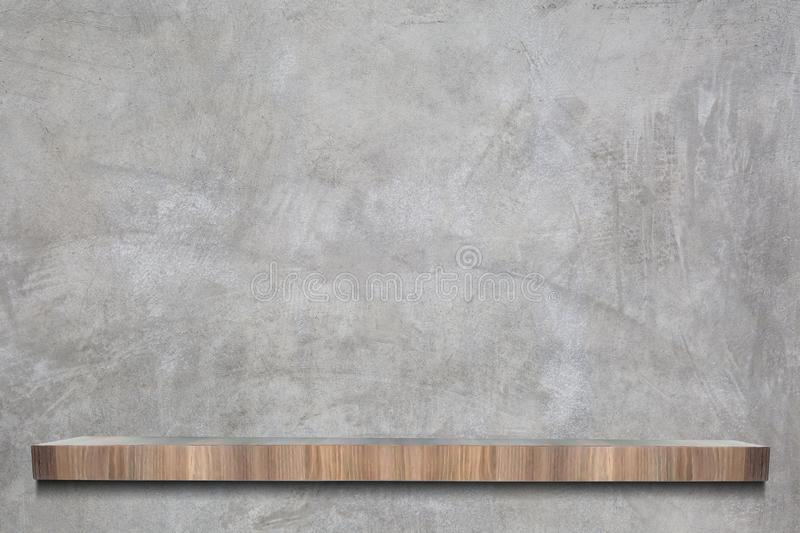 Raw cement or concrete wall with empty wooden shelves in loft Style for background royalty free stock images