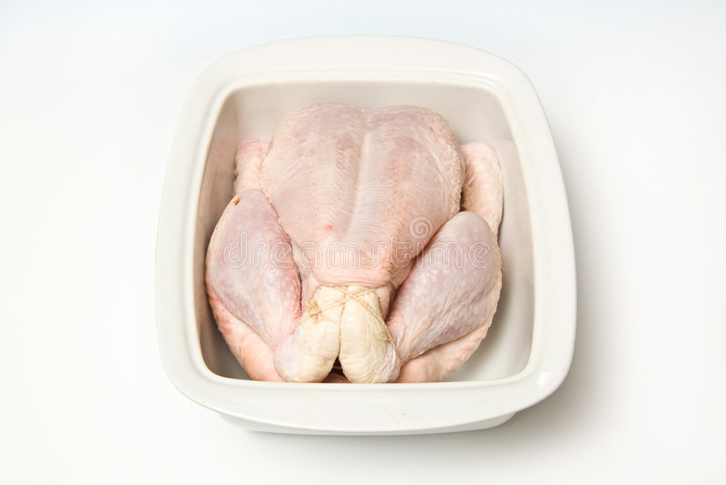 Raw chicken in baking tray stock photos
