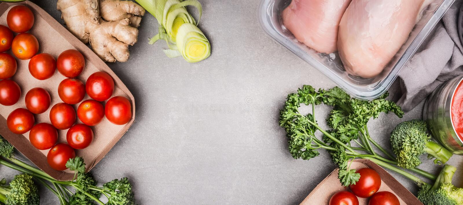 Raw chicken breast fillet and various vegetables ingredients for tasty diet cooking, gray stone background , top view, copy spac. E, banner royalty free stock photography