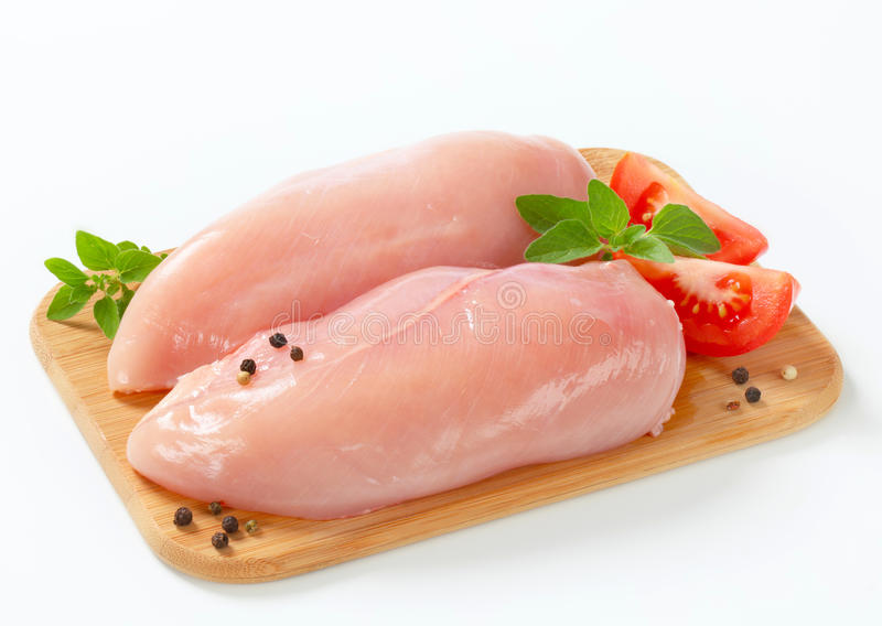 Raw chicken breast fillets stock photos