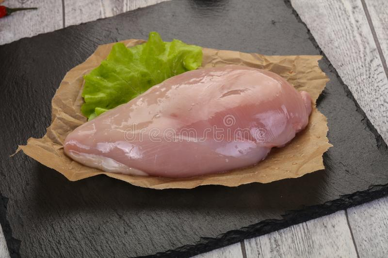 Raw chicken breast stock images