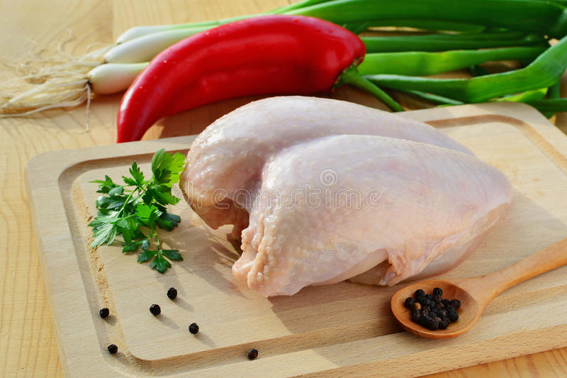 Raw chicken breast with skin and vegetables stock photo