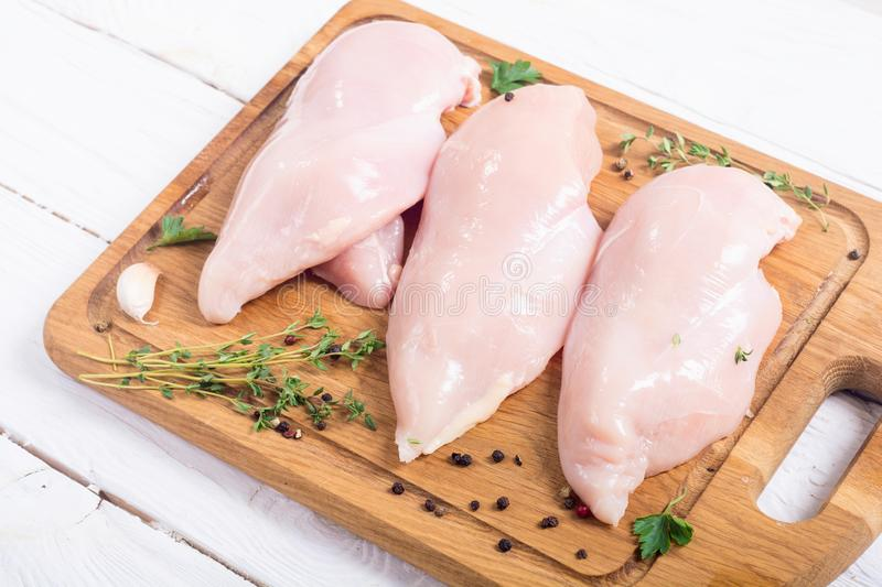 Raw chicken breast with spices royalty free stock images