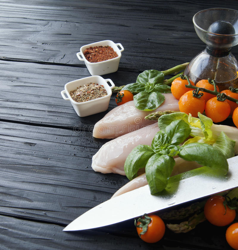 Raw chicken breasts with herbs spices royalty free stock photos