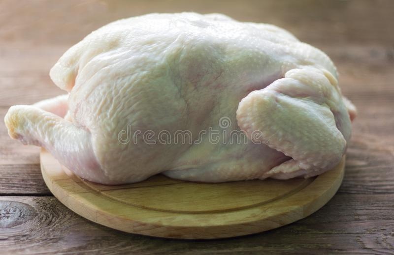 raw chicken, broiler chicken carcass on cutting Board stock images