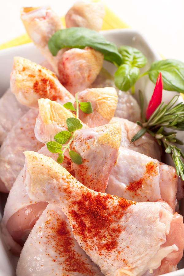 Raw chicken drumsticks royalty free stock images