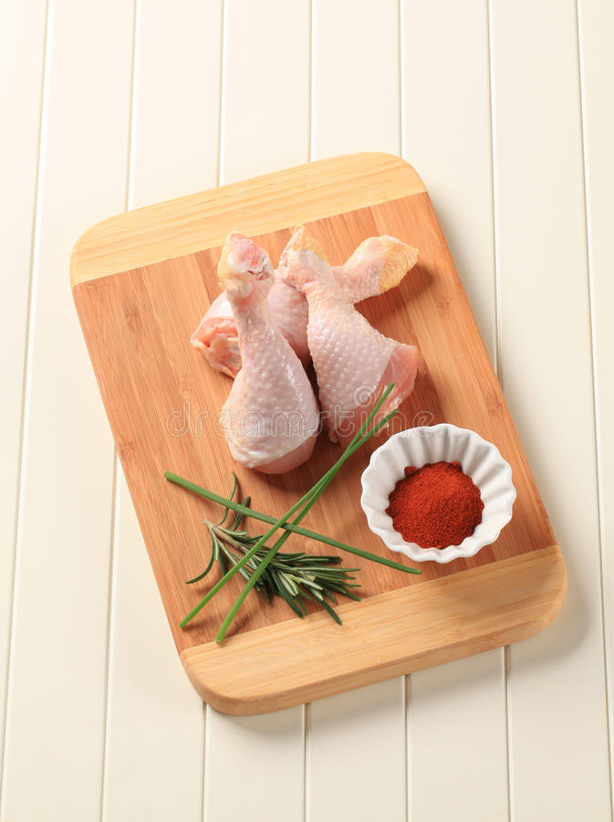 Raw chicken drumsticks royalty free stock photo