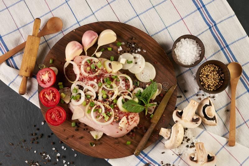 Raw chicken fillets with fresh vegetables royalty free stock photo