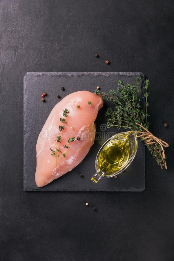Raw chicken fillets with spices and herbs. royalty free stock photos