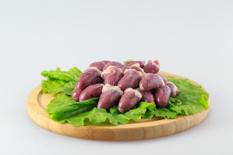 Raw chicken hearts on a white background royalty free stock photo