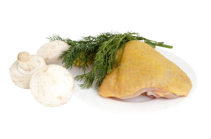 Raw chicken leg on a plate, mushrooms and dill greens stock photos