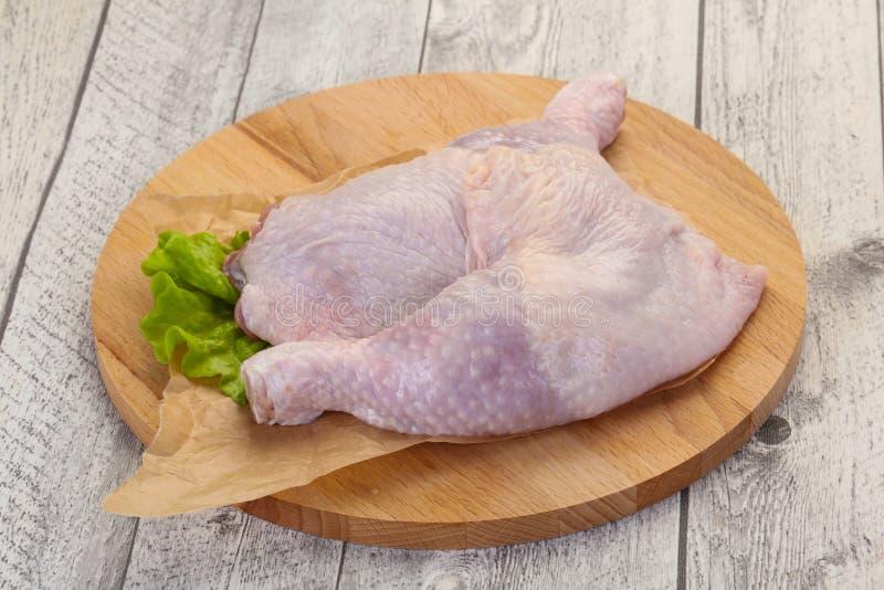 Raw chicken leg stock image