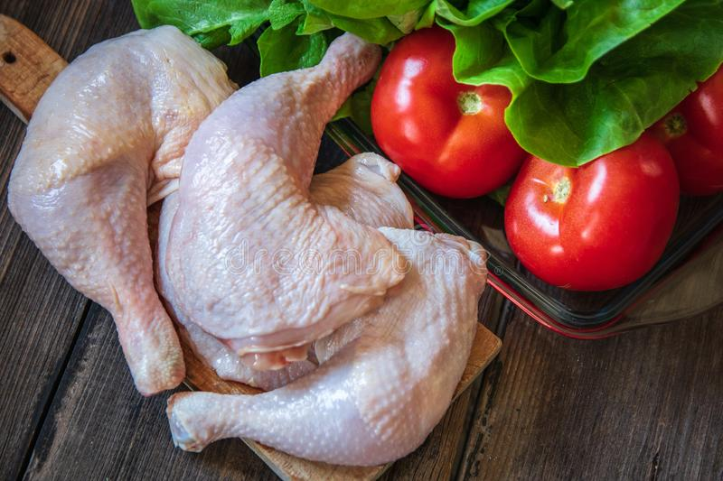 Raw chicken legs on cutting board royalty free stock photography