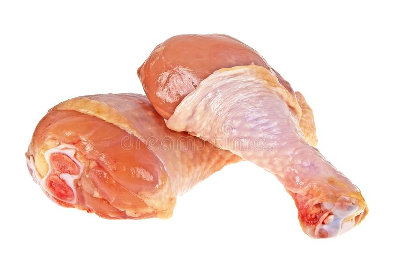 Raw chicken legs on a white background royalty free stock photography