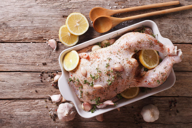 raw chicken marinated with garlic, herbs, spices and lemon. Horizontal top view stock photography