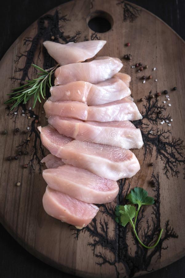Raw chicken meat. Served sliced raw chicken file with spices,selective focus royalty free stock images