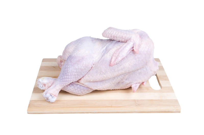 Raw chicken relaxing on a board royalty free stock photos