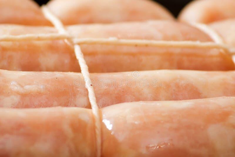 Raw chicken sausage stock photos