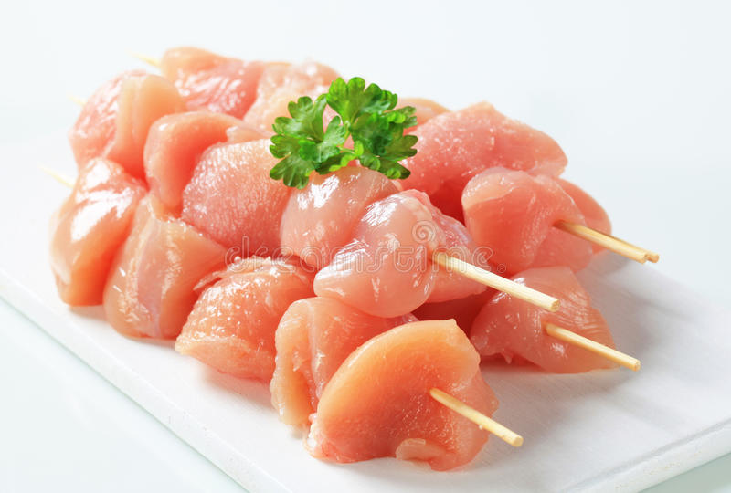 Raw chicken skewers stock photography