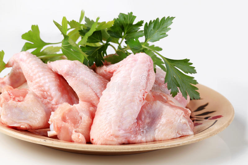 Raw chicken wings royalty free stock photos