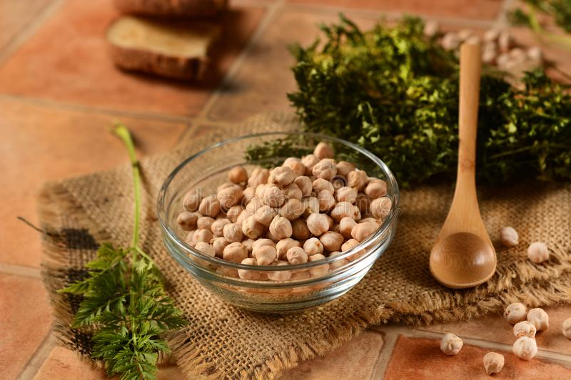 Raw chickpeas in the glass bowl stock images